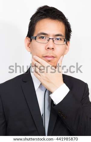 Uhm i think about this business, Portrait of business asian smart man on white background - stock photo