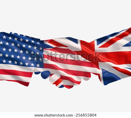 UK and US flags with a handshake on a white background - stock photo