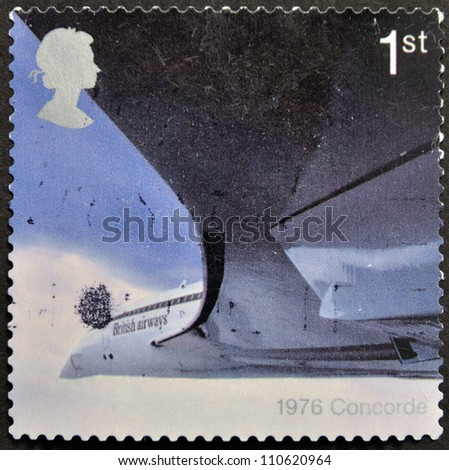 UK - CIRCA 2002: A stamp printed in Great Britain dedicated to 50th Anniversary of Passenger Jet Aviation, Airliners, shows Concorde (1976), circa 2002 - stock photo