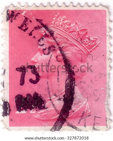 UK-CIRCA 1993: A stamp printed in UK shows image of Elizabeth II is the constitutional monarch of 16 sovereign states known as the Commonwealth realms, in Rose Red, circa 1993. - stock photo