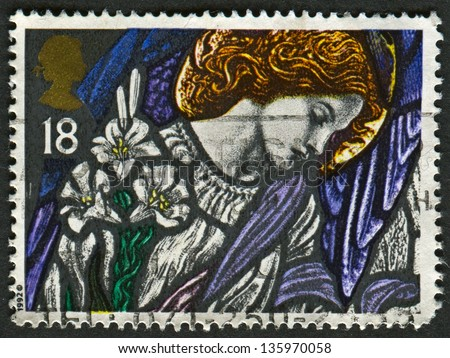 UK - CIRCA 1992: A stamp printed in UK shows image of The Angel Gabriel, St James, Pangbourne, Stained Glass Windows, circa 1992.