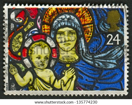 UK - CIRCA 1992: A stamp printed in UK shows image of The Madonna and Child, St. Marys Bilbury.Christmas. Stained Glass Windows, circa 1992.