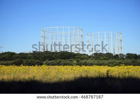 UK gas holders in the countryside on bright sunny day
