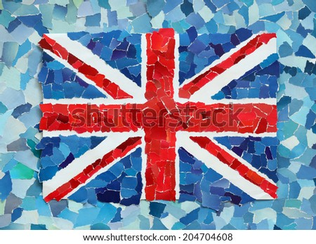 UK national flag made from many pieces of torn paper on sky blue background