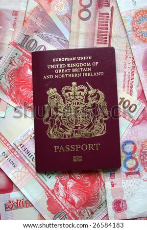 UK passport on Hong Kong dollars - stock photo