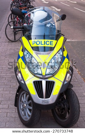 UK Police scooter parked on a path in London - stock photo