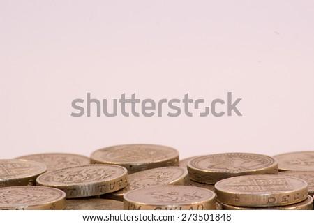 UK Pound Coins on white background - stock photo
