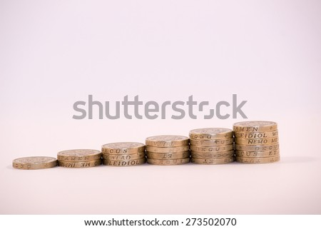 UK Pound Coins stacked in columns symbolising growth - stock photo