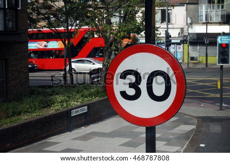 UK, Road Traffic Sign, Speed Limit 30 Mph on street view background