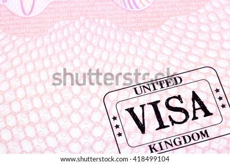 UK visa immigration stamp passport page close up, copy space - stock photo