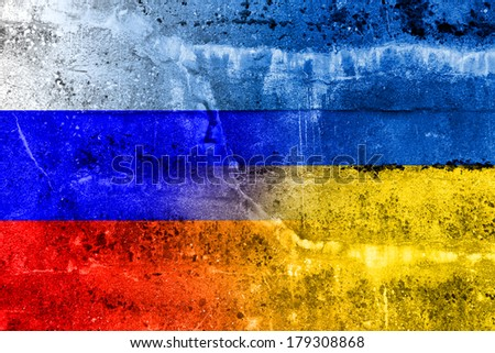 Ukraine and Russia Flag painted on grunge wall - stock photo