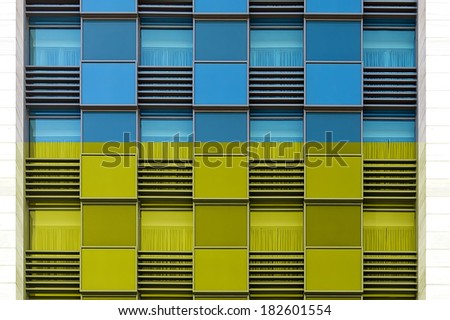 Ukraine blue and yellow color windows of modern office building horizontal background - stock photo