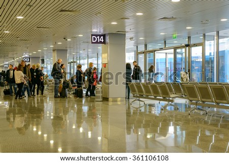 Ukraine, Borispol-26 October 2015:Passengers waiting in a departures hall at an airport or train station standing in line ready to board their plane, travel concept - stock photo