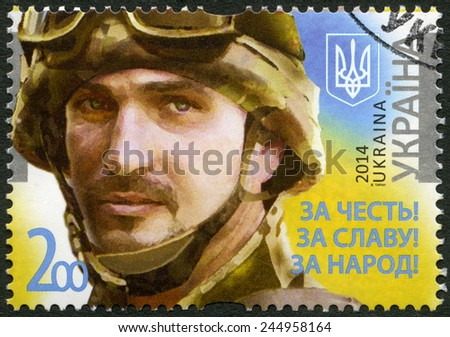 """UKRAINE - CIRCA 2014: A stamp printed in Ukraine shows portrait of soldier with the call sign """"Frenchman"""", Legends of Armed Forces of Ukraine, For the honor! For the glory! For the people!, circa 2014 - stock photo"""