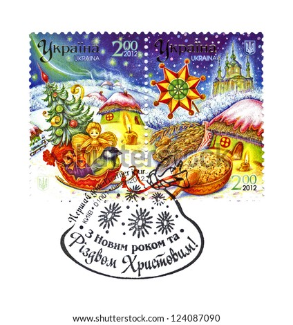 UKRAINE - CIRCA 2012: stamp on Premier jour holiday envelope printed in UKRAINE, shows Ukrainian winter landscape and Christmas gifts, circa 2012. Happy New Year and Marry Christmas as text. - stock photo