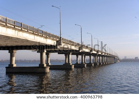 Ukraine. Dnepropetrovsk. Central bridge across the Dnieper River in the early morning.