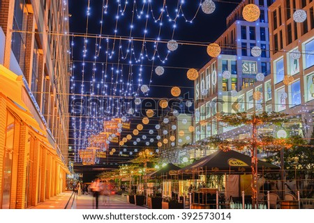 Ukraine, Dnepropetrovsk - MAY 18, 2015: Night view of the Ekaterininsky area in city. Area illuminated by street lighting. business centers and shops, colorful advertising.  - stock photo
