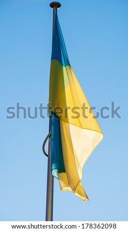 Ukraine flag on a blue clear sky in Strasbourg, France - in front of the Council of Europe - stock photo