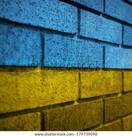 Ukraine flag painted on dark wall - stock photo