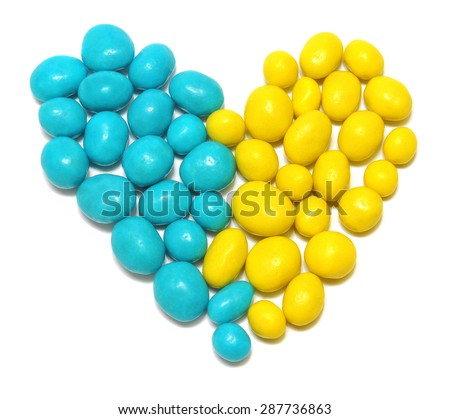 Ukraine heart flag colors of sweet candy jelly beans isolated on a white background