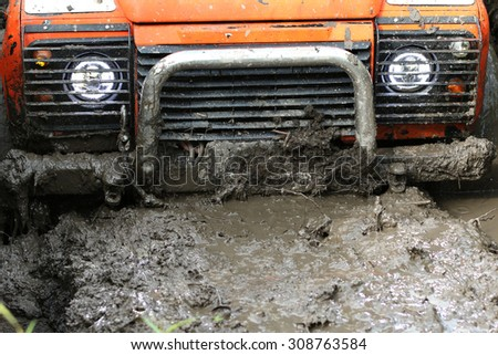 UKRAINE - JULY 28 - Land Rover Defender sinks in mud during a race on July 28, 2015 in Ukraine. - stock photo