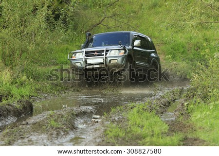 UKRAINE - JULY 28 - Mitsubishi Pajero Wagon jumps into the water during the race on July 28, 2015 in Ukraine.