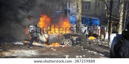 Ukraine, Kiev, 18 February 2016: Riots in the city, citizens in conflict with the power harness tires and vehicles police disperse demonstrators in Europe, protesting people fighting for their rights