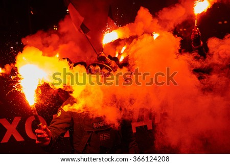 UKRAINE, KIEV - JANUARY 22, 2016: Different nationalist parties supporters burn torches during their march to mark the Unification Day of East and West Ukraine from 1919.