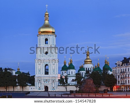 Ukraine Kiev Kyiv ancient historic landmark Sofia monastery and cathedral at sunrise square monument and bronze horse statue - stock photo