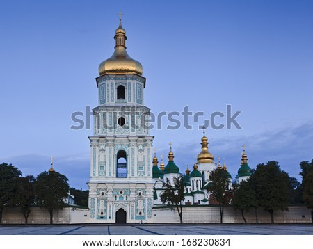 Ukraine Kiev Sofia ancient monastery complex of buildings of entrance gate bell tower and other cathedral domes at sunrise - stock photo