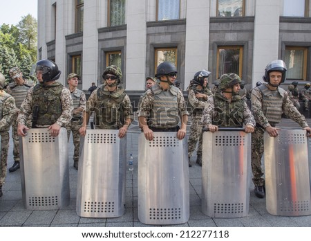 UKRAINE, KYIV - 14 Aug, 2014: Protesters blocked the passage near the Ukrainian Parliament and surrounded almost the entire building.