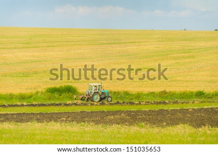 Ukraine - landscape with a tractor working on fields