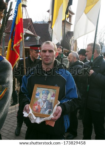 UKRAINE, LUGANSK - JANUARY 12, 2014: Religious procession dedicated to the 380th anniversary of Pereyaslavska Radaon the street of city