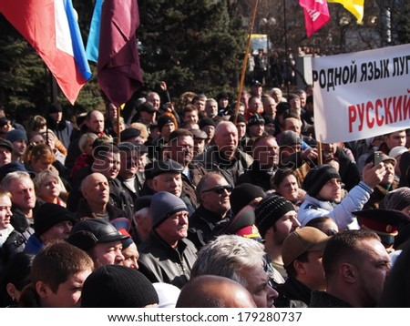 "UKRAINE, LUGANSK - March 1, 2014: Supporters of the old regime rally ""against anarchy and disorder"". The rally soon turned to support the Russian occupation of Crimea"
