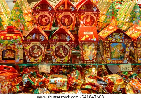 "Ukraine, Lviv - December, 15, 2016: Company store confectionery ""Roshen"" in Lviv on Viacheslava Chornovola Ave. Sale of holiday gifts, sets of chocolates for Christmas and New Year."