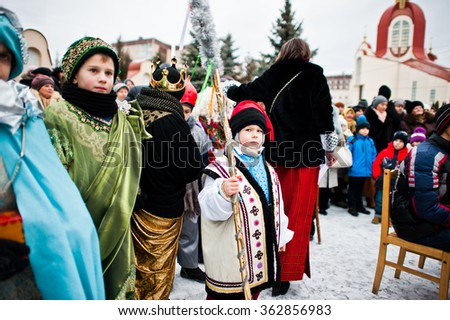 UKRAINE. LVIV - JANUARY 14, 2016: Christmas nativity scene parade of children on winter day.
