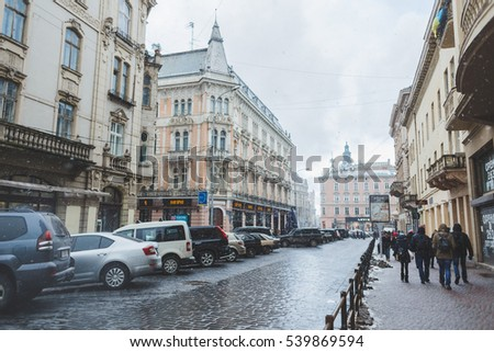 Ukraine, Lviv - JANUARY 4, 2015: Residents and tourists in the streets of Lviv. Photographed creative lens Lensbaby Edge 80 Optic.