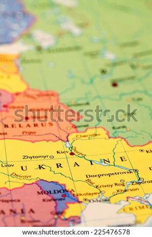 Ukraine on atlas world map - stock photo