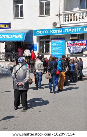 Ukraine, Sevastopol -  March 21 2014 : Crowd of people in Sevastopol city center waits in queue to make a photo for a new russian passport on March 21, 2014  - stock photo