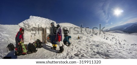 Ukraine, Vorohta- January 7, 2015: A group of athletes at an alpine refuge prepares modern equipment for training climb to the highest point Ukraine- mountain Goverla