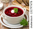 Ukrainian and russian national red borsch with sour cream closeup - stock photo