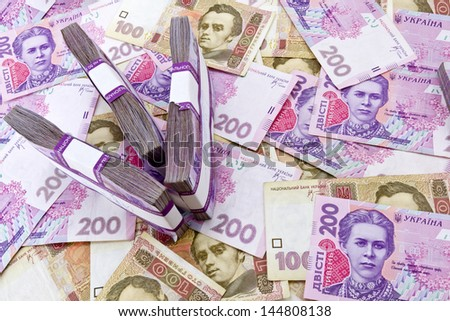 Ukrainian banknotes background with arrow shape made of money stacks. Money inflation concept.
