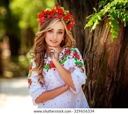 Ukrainian beautiful girl in national clothes - stock photo