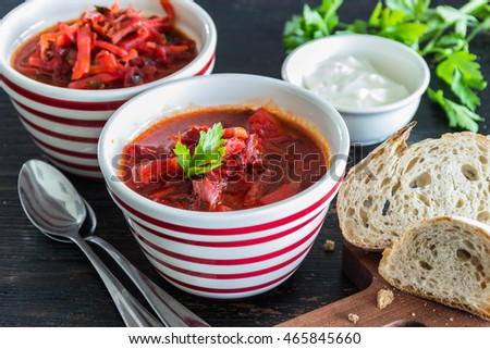 Ukrainian beetroot soup - borscht, on napkin, on wooden background.