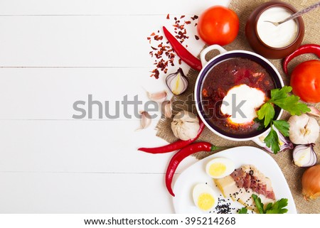 Ukrainian beetroot soup - borscht, on wooden background with ingredients - stock photo
