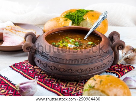 Ukrainian borsch with donuts, onion and garlic