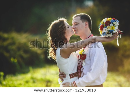 Ukrainian brides in traditional costumes embroidered shirts outdoors - stock photo