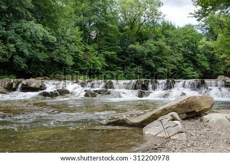 Ukrainian Carpathian mountains.Waterfall - stock photo