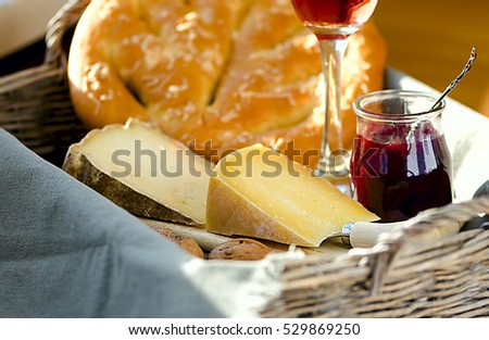 Ukrainian cheeses made from cow milk: Tsysarskiy )aka French Tomme) and Cimbor, served with rose wine, italian bread fougasse, cherry and basil sauce and walnuts