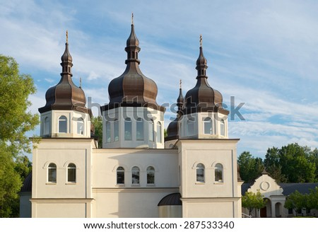 ukrainian church architecture of baroque style and copper clad domes with cupolas and crosses - stock photo